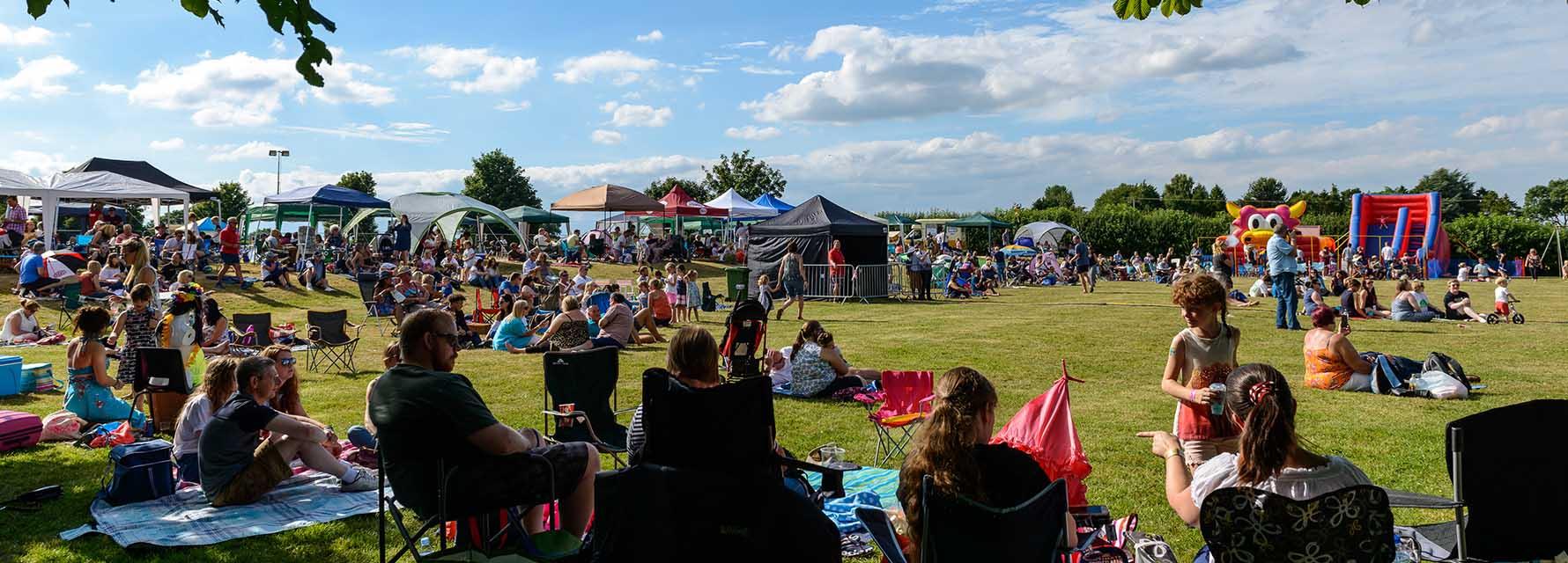 image of everyone enjoying the sunshine at Pattishall Picnic in the Park